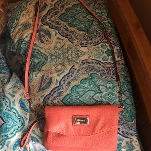 Pink/peachy colored cross body bag